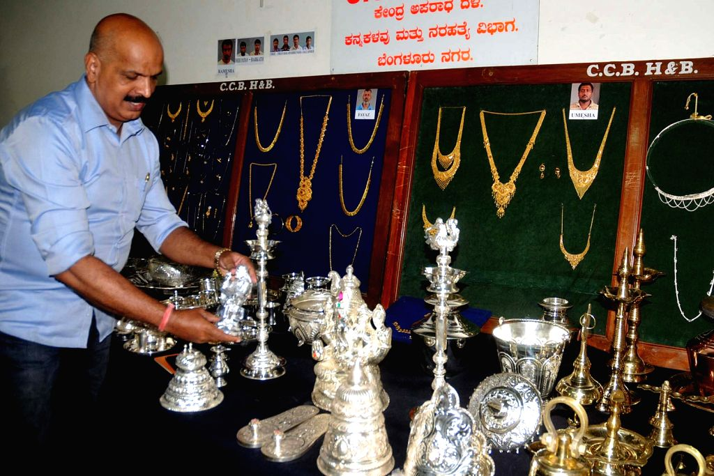 Police officer inspecting recovered jewels and silver items which were recovered by CCB police personnel from the thieves during the press conference at Police Commissioner Office in Bengaluru on 2nd