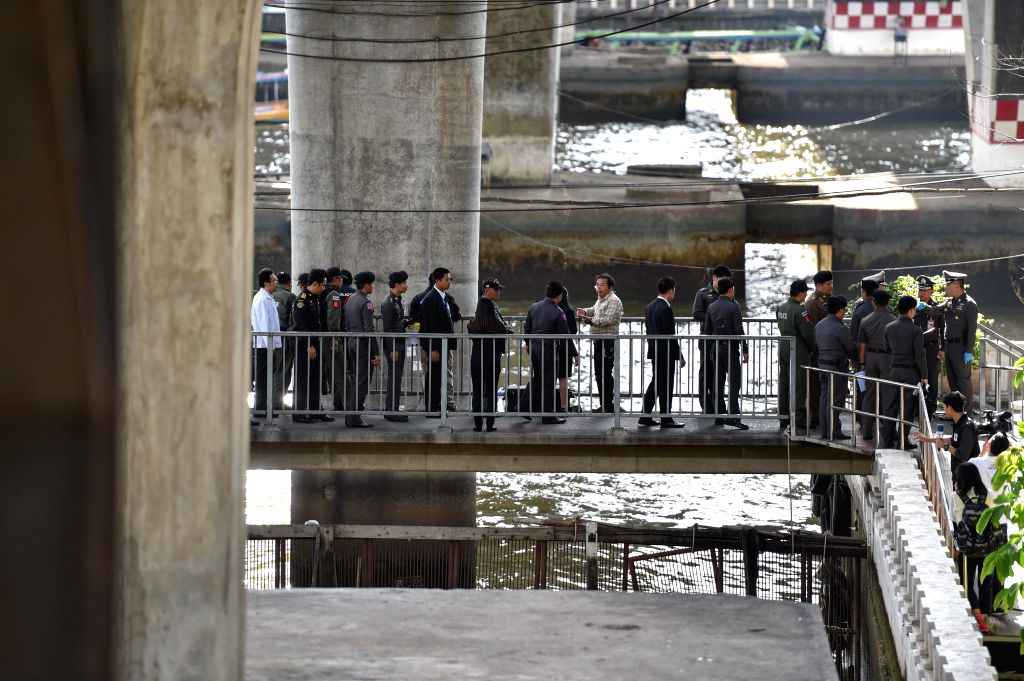 Police officers investigate the explosion site at a wharf of the Chao Phraya river in Bangkok, Thailand, on Aug. 18, 2015. No casualties were reported. (Xinhua/Li ...