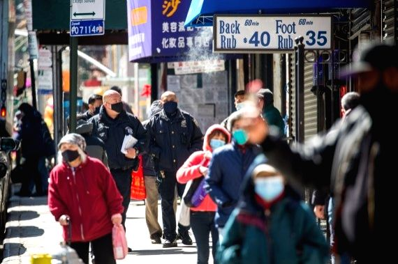 Police officers patrol in Chinatown of New York, the United States, March 19, 2021.