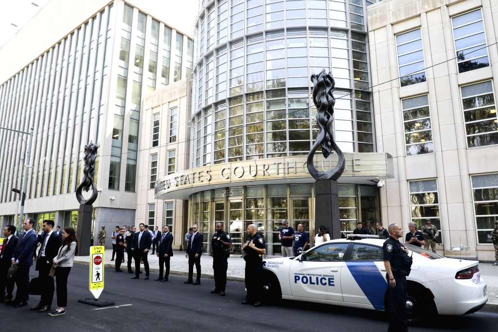 (Police officers stand guard outside a federal court in New York City's Brooklyn borough, the United States, July 17, 2019. U.S. judges have sentenced Mexican drug ...
