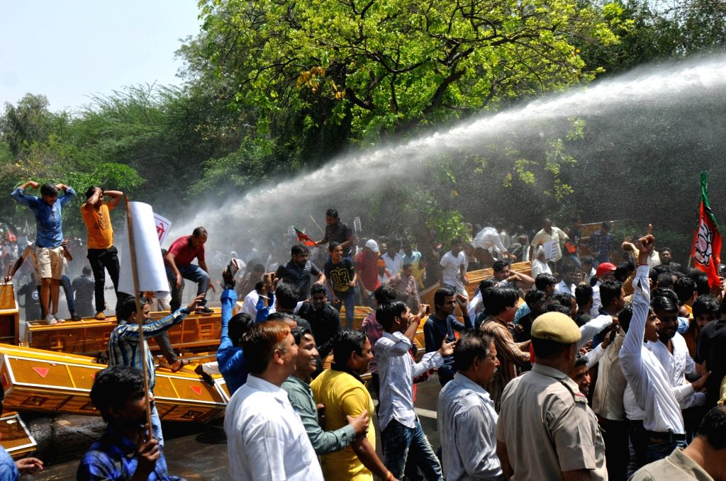 Police opens water canons at BJP workers staging a demonstration outside Delhi Chief Minister Arvind Kejriwal's residence over the alleged ration scam, in New Delhi on April 7, 2018. - Arvind Kejriwal