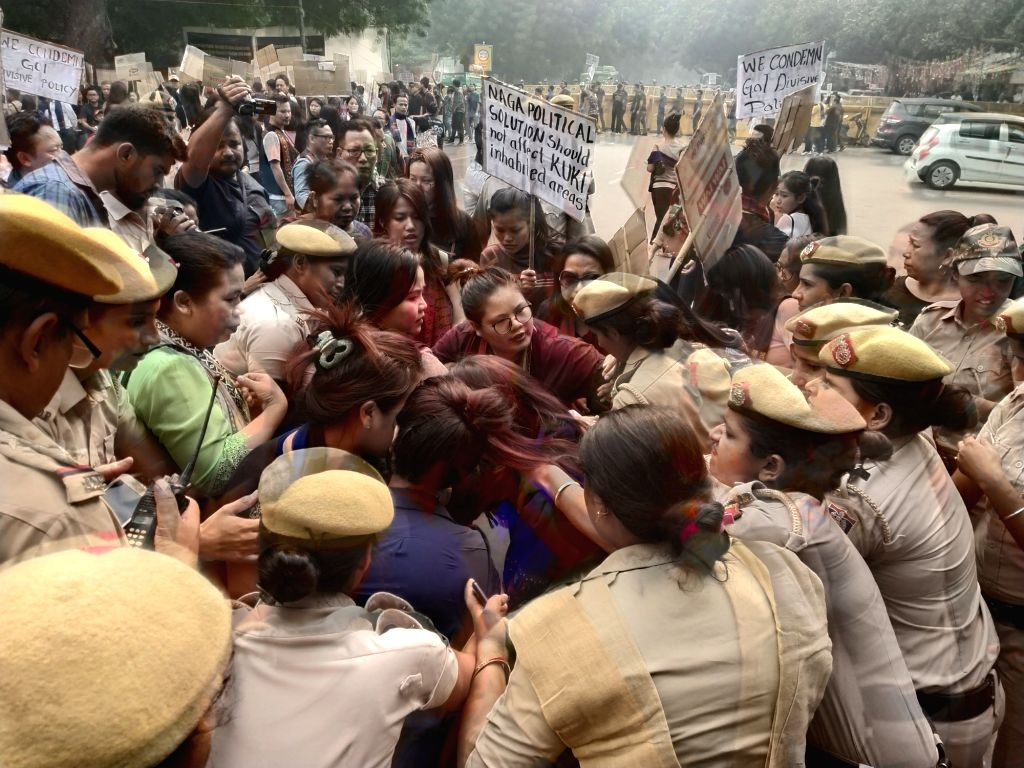 Police personnel along with the members of the Kuki tribe stop a girl who was trying to immolate herself during the community's protest over their various demands including the inclusion ...