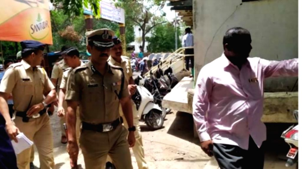 Police personnel arrive to carry out investigation at Muthoot Finance office where one staffer was killed and two others injured when four dacoits carried out an armed robbery in Nashik, ...