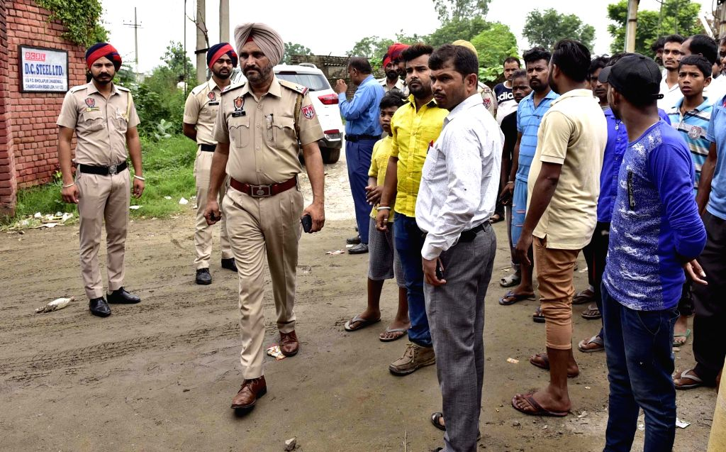 Police personnel arrive to carry out investigation at the iron furnace unit where two labourers were killed and 12 others injured in a blast, in Punjab's Ludhiana on July 26, 2019.