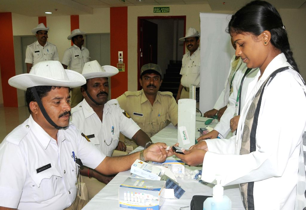 Police personnel at a free health check-up camp set-up by a private hospital in Bangalore on August 1, 2014.