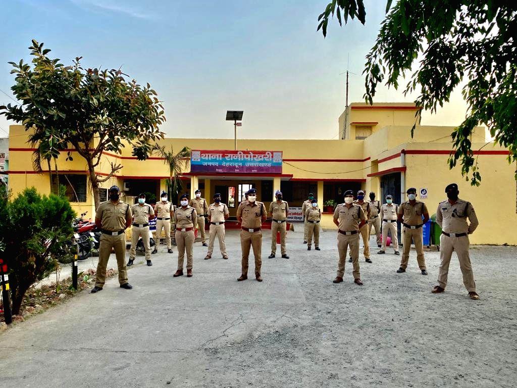 Police personnel at Dehradun's Rani Pokhari police station.