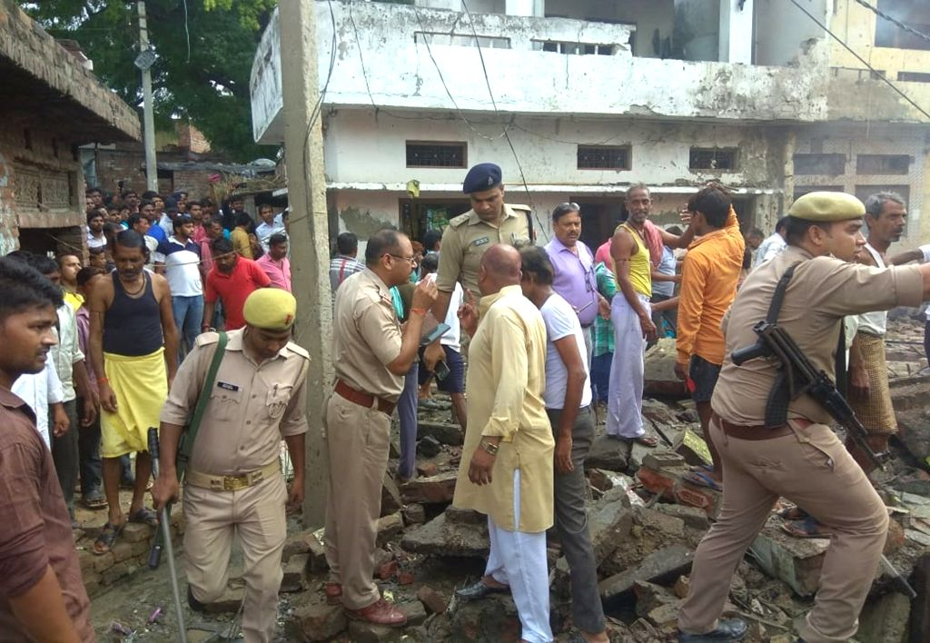 Police personnel at the cracker factory where six people, including the owner, were killed and several others injured in a blast, in Etah district of Uttar Pradesh on Sep 21, 2019.