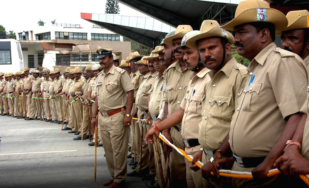 Police personnel at the site where drivers of taxi and buses demonstrate against hike in toll at Kempegowda International Airport in Bangalore on May 6, 2014.