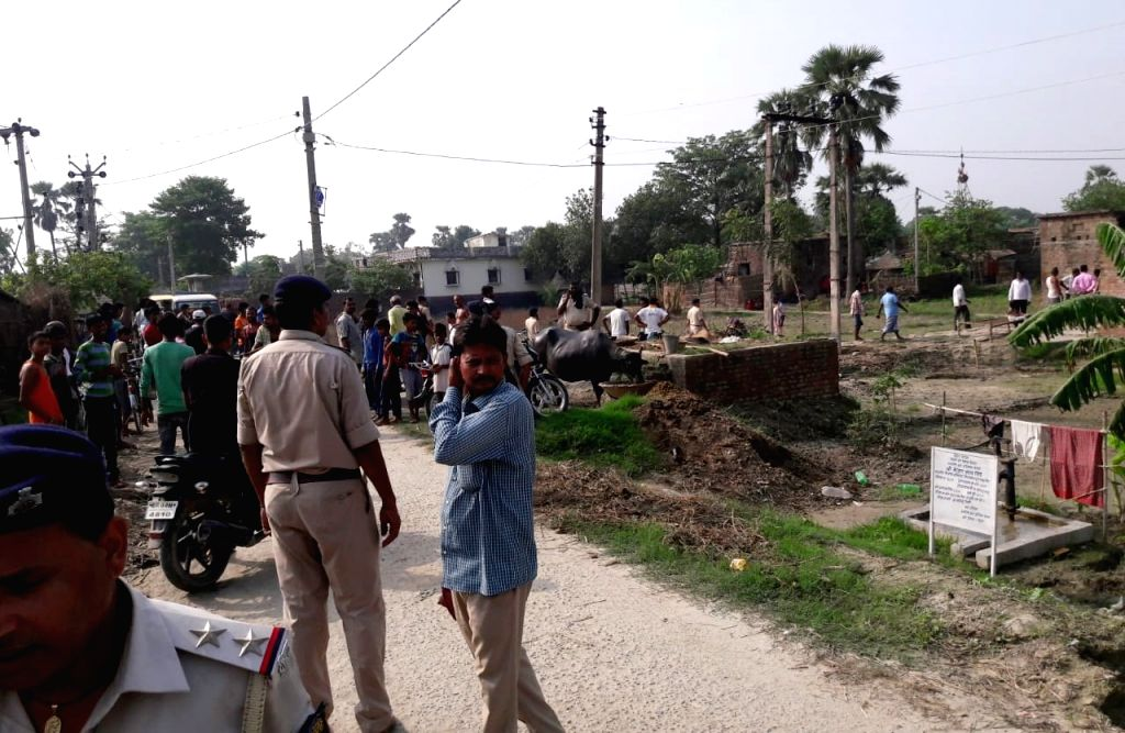 Police personnel at the site where three men were allegedly thrashed to death and one critically injured by villagers over suspicion of cattle theft in Bihar's Saran district on July 19, 2019. ...