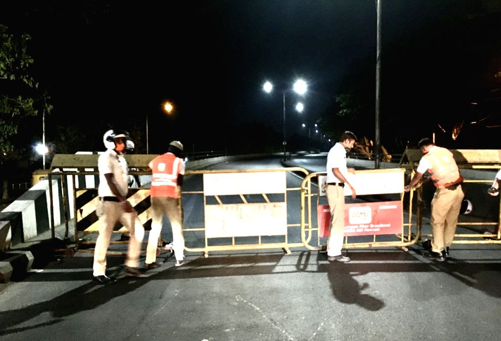 Police personnel barricades to close the roads during Corona night curfew imposed due to surge in COVID-19 cases across the country, in Bengaluru on Saturday 10th April 2021