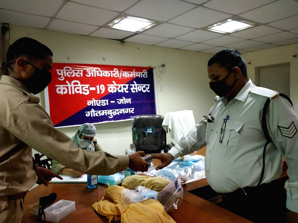 Police personnel being screened for coronavirus at COVID Care Center.