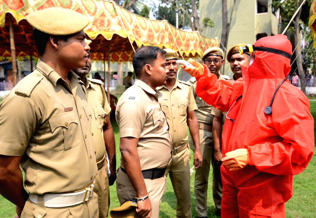 Police personnel being screened for COVID-19 (coronavirus) at the Bodyguard Police Line Ground in Kolkata, on March 18, 2020.