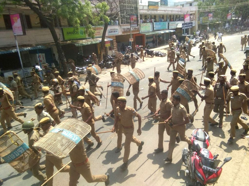 Police personnel carry out baton charges to bring the protesters under control during protests for the closure of Vedanta's Sterlite copper smelter in Tamil Nadu's Thoothukudi district; in ...