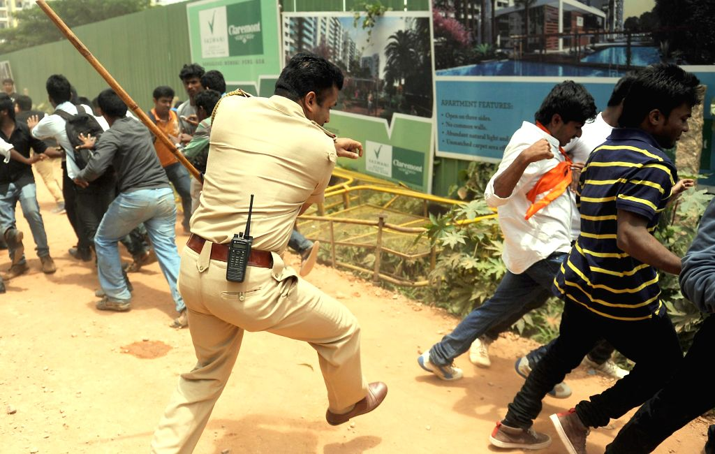Police personnel charge batons on ABVP activists during a demonstration against alleged rape of a 6-year-old student in Bangalore on July 21, 2014.