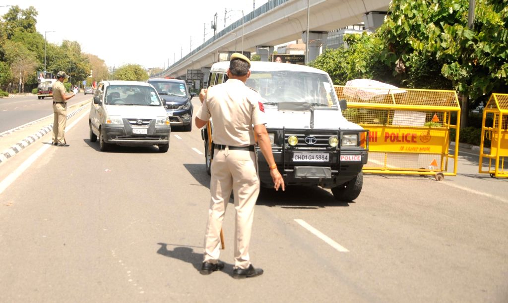 Police personnel checking vehicles at Delhi's Lajpat Nagar on Day 6 of the 21-day nationwide lockdown imposed to contain the spread of coronavirus, on March 30, 2020.