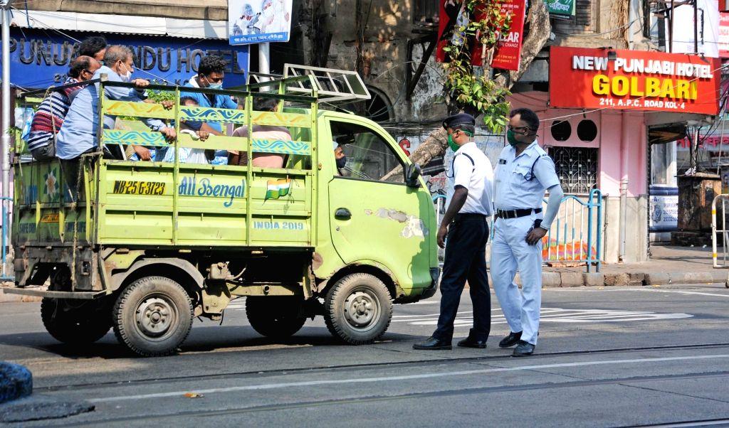 Police personnel checking vehicles at Naka Point during the lockdown on Coronavirus pandemic in Kolkata on Sunday, May 16, 2021.