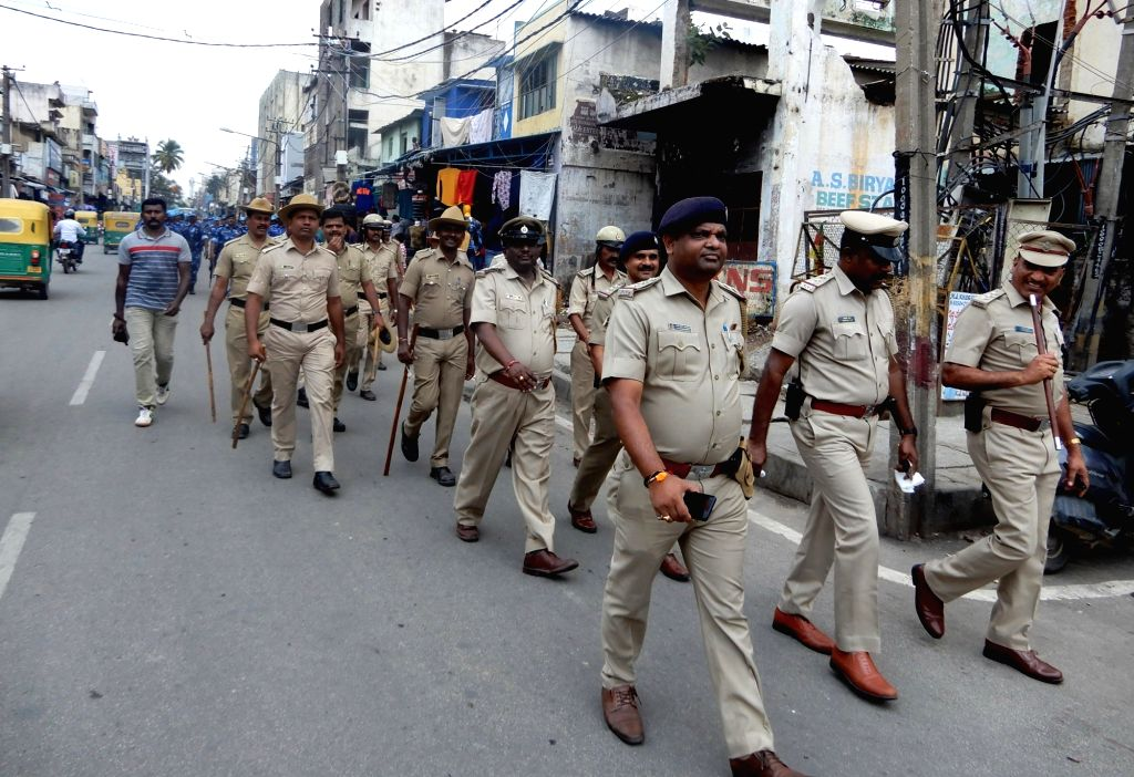 Police personnel conduct flag march ahead of Ganesha idol immersion ceremony, in Bengaluru on Sept 15, 2018.