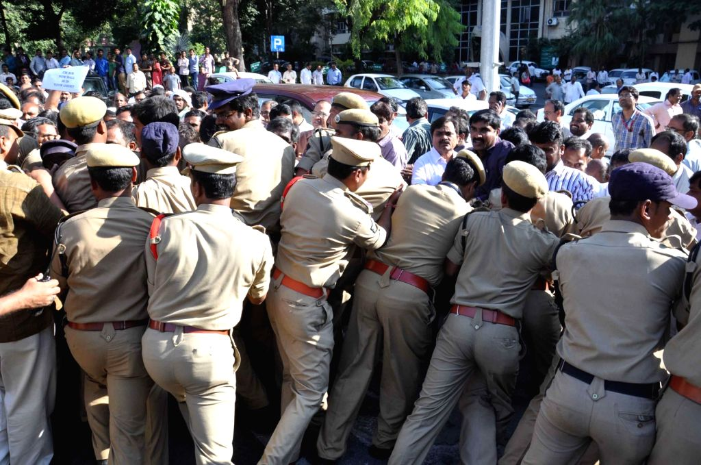 Police personnel deployed as Telangana Non Gazetted Officer's Association and Andhra Pradesh Non Gazetted Officer's Association clash at Andhra Secretariat in Hyderabad on Dec.13, 2013.