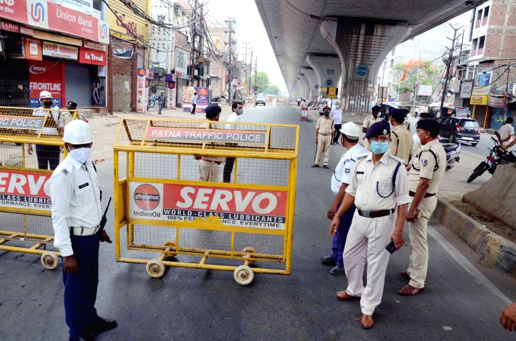 Police personnel deployed at Raja Bazar in Patna's Khajpura that was sealed after one person in the locality tested positive for COVID-19, during the extended nationwide lockdown imposed to ...