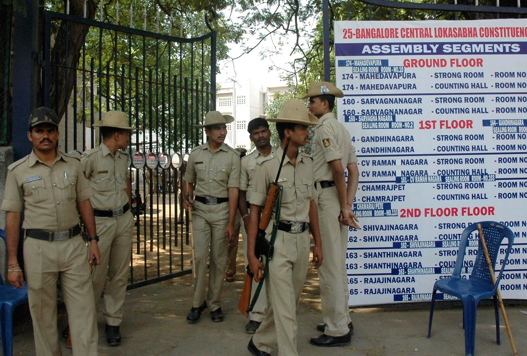 Police personnel deployed outside a strong room at Home Science College in Bangalore on April 18, 2014.