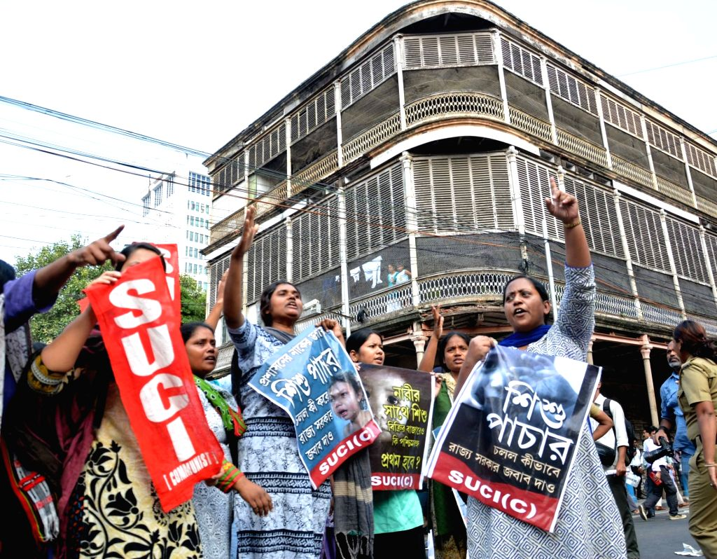 Police personnel detain SUCI activists during their demonstration against child trafficking in front Raj Bhavan in Kolkata on Nov 29, 2016.