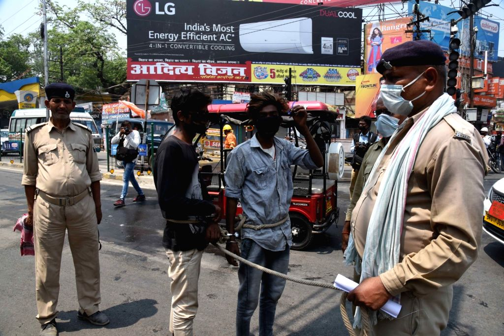 Police personnel get prisoners sanitised before lodging them in jail in Patna during the extended nationwide lockdown imposed to mitigate the spread of coronavirus; on Apr 23, 2020.