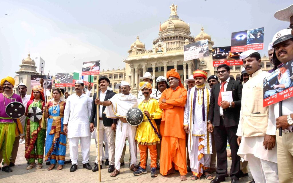 Police personnel in traditional attires to create awareness on traffic rules on the 30th National Road Safety Week in Bengaluru, on Feb 9, 2019.