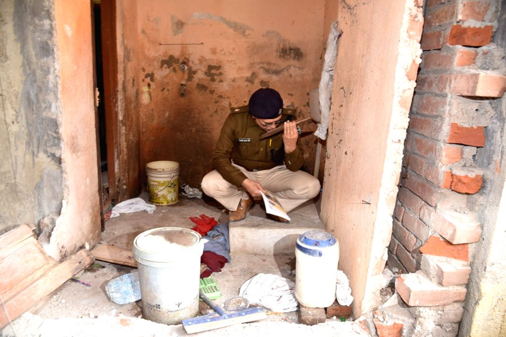 Police personnel inspect the site where at least six people were injured in an explosion near Gandhi Maidan area of Patna on Feb 10, 2020. The explosion took place in a house at Daldali Road ...