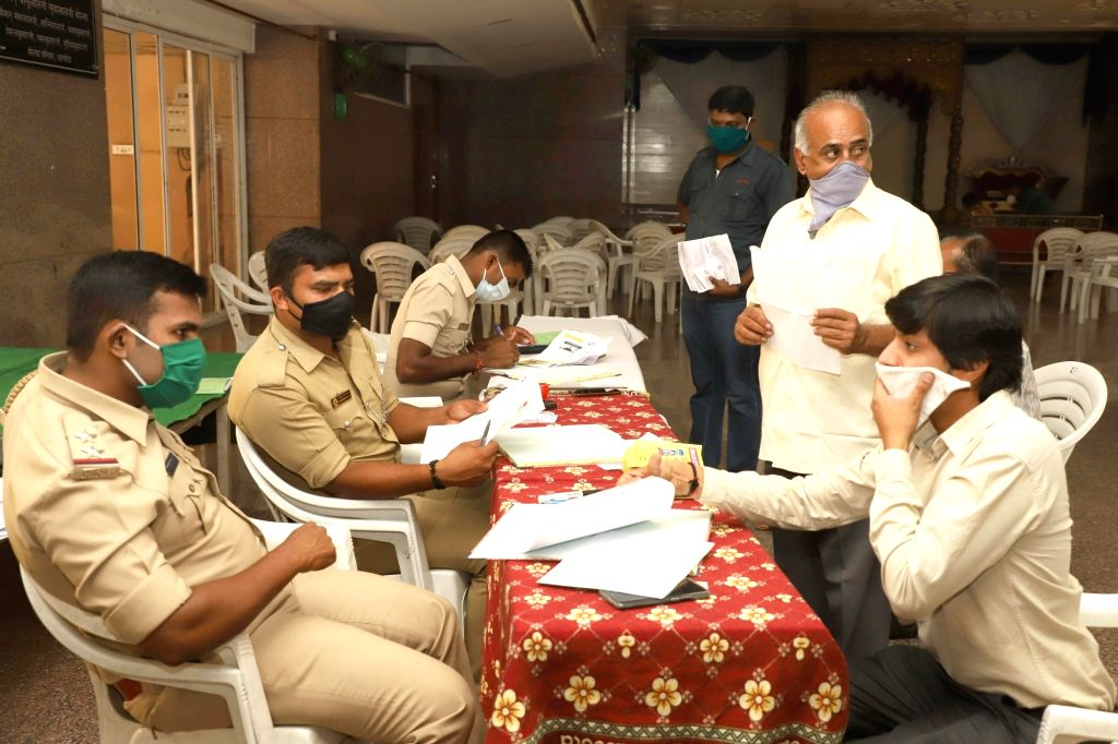 Police personnel issuing passes to essential service providers on Day 2 of the 21-day nationwide lockdown imposed by the Narendra Modi government over the coronavirus pandemic; in ... - Narendra Modi