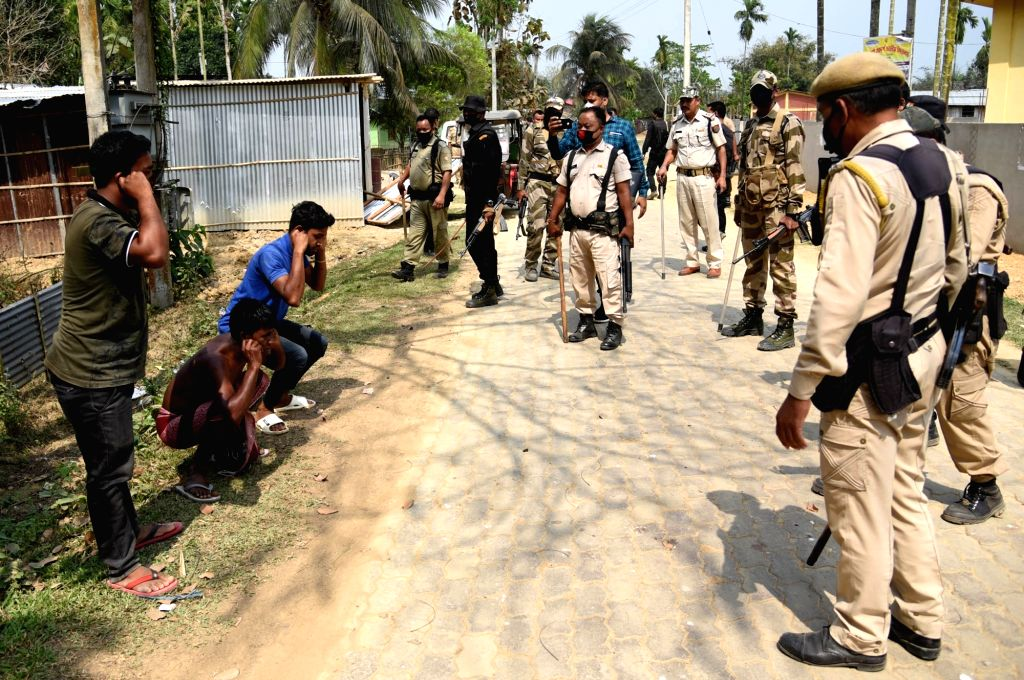 Police personnel make curfew violaters hold their ears and perform sit-ups as a punishment on Day 5 of the 21-day countrywide lockdown imposed to contain the spread of novel coronavirus, at ...