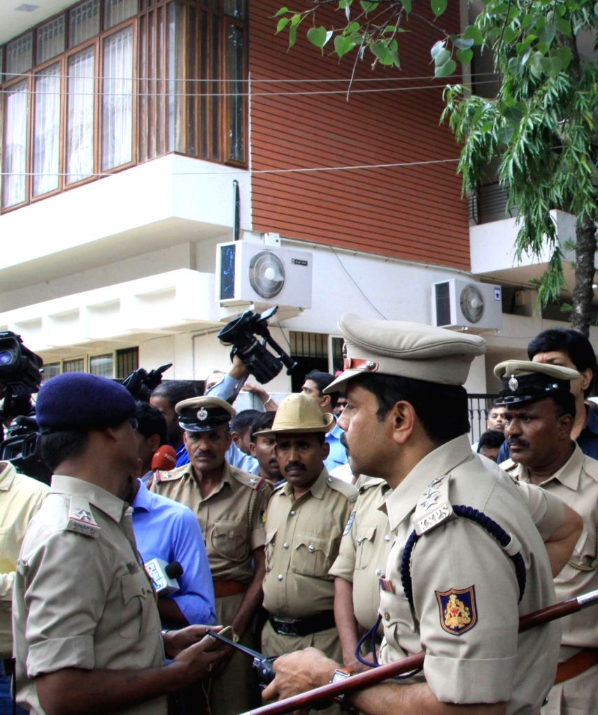 Police personnel outside the residence of Karnataka Energy Minister DK Shivakumar during the Income Tax department raids in Bengaluru on Aug 2, 2017. - D