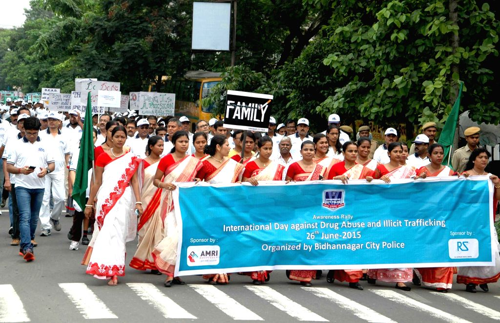 Police personnel participate in a rally organised by Bidhannagar City Police on the occassion of the International Day Against Drug Abuse and Illicit Trafficking in Kolkata on June 26, 2015.