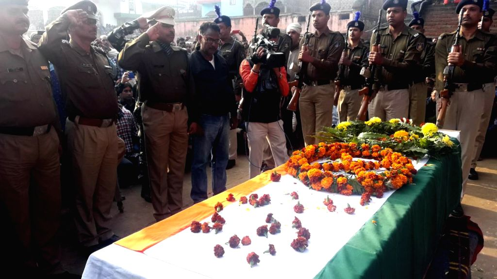 Police personnel pay tributes to the mortal remains of CRPF trooper Constable Mujahid Khan who was killed in Sunjuwan Army camp terror attack; in Patna on Feb 14, 2018. - Mujahid Khan