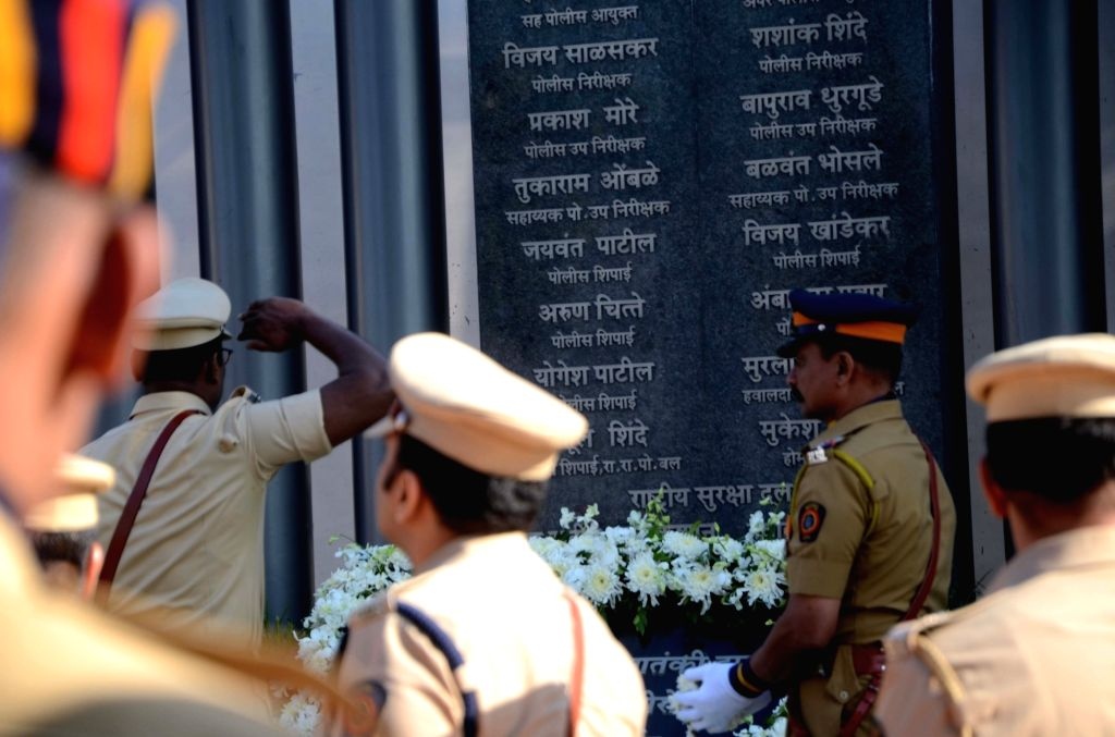Police personnel pays tribute during a programme organised on 8th anniversary of 26/11 Mumbai terror attacks at Police Gymkhana in Mumbai on Nov 26, 2016.