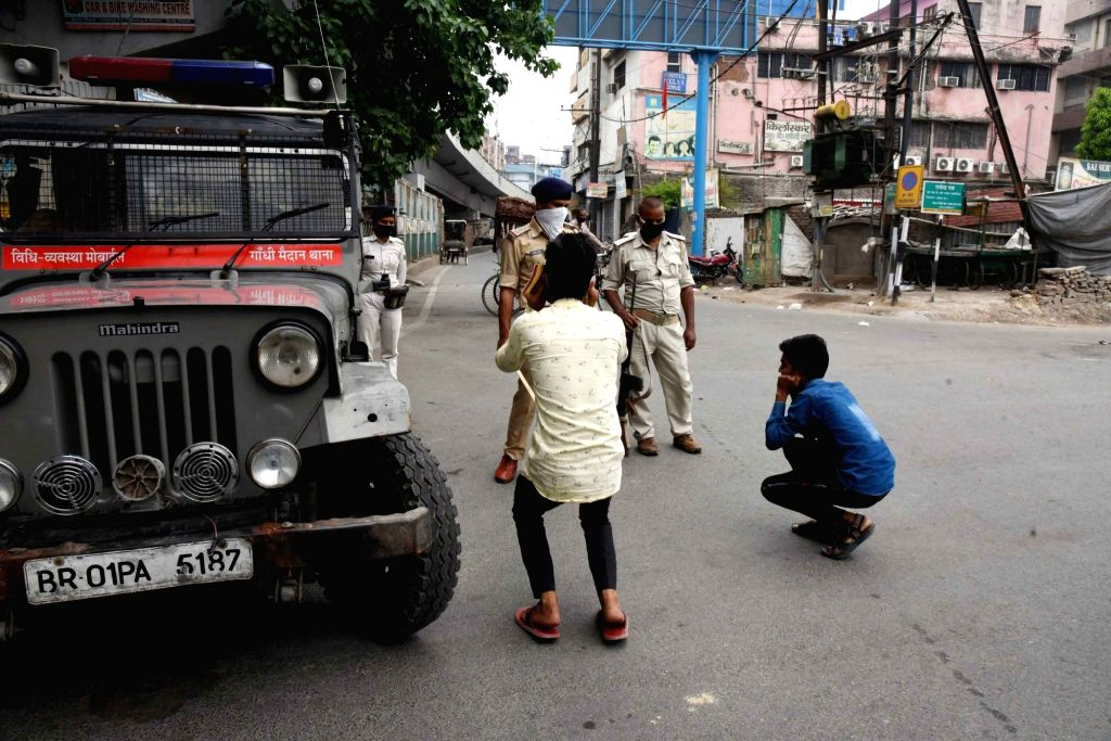 Police personnel punish the curfew viokaters by making them perform sit-ups in Patna during the extended nationwide lockdown imposed to mitigate the spread of coronavirus; on Apr 24, 2020.