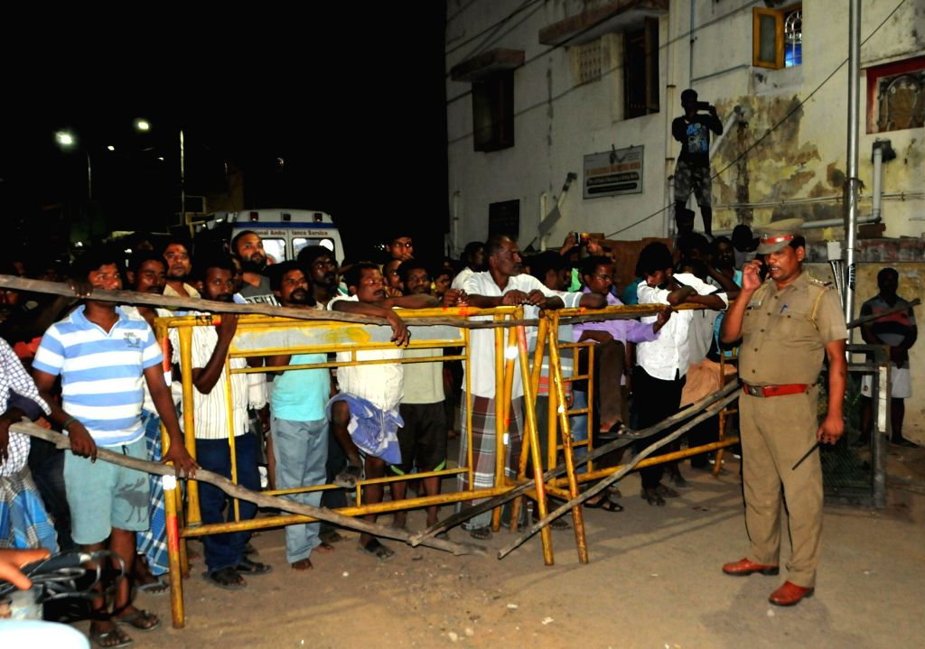 Police personnel put barricades during rescue operations at the site where a shed of an under construction hospital collapsed near Taramani in Chennai on July 21, 2018. The incident ...