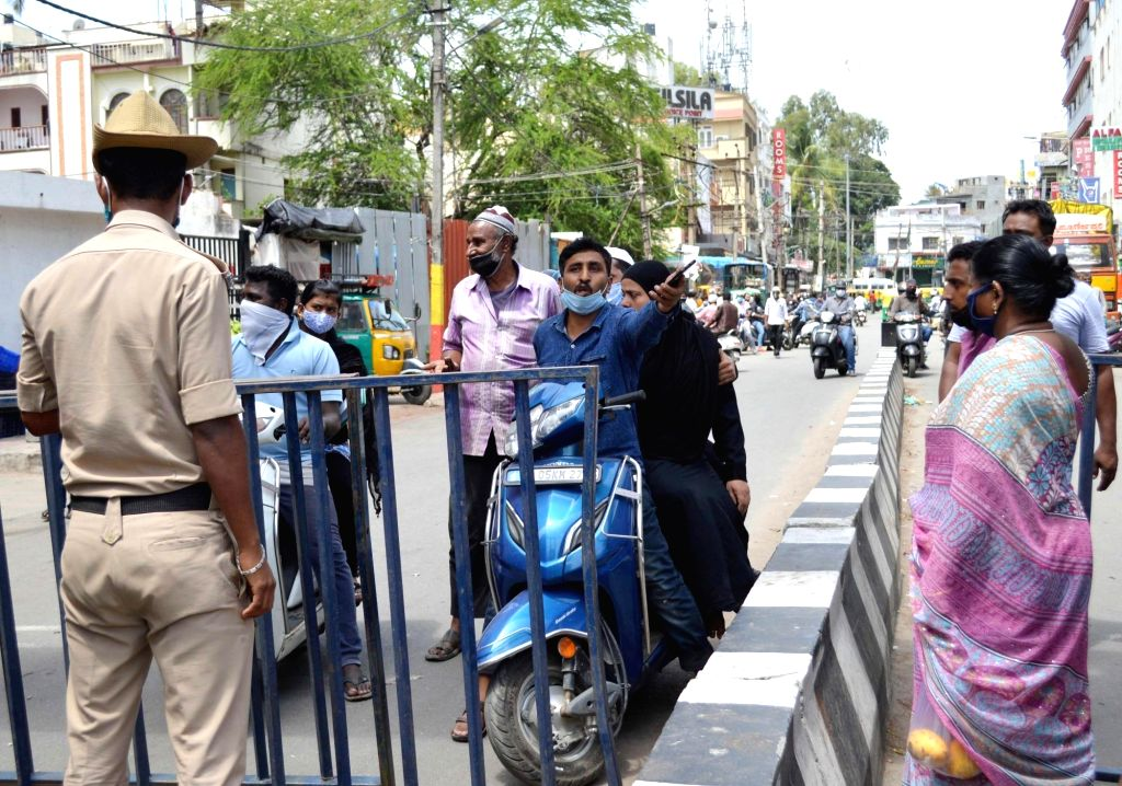 Police personnel seal a road in Tank Garden near NIMHANS during a strict lockdown that has been re-imposed for 15 days in five wards across Bengaluru to contain the spread of COVID-19 and ...