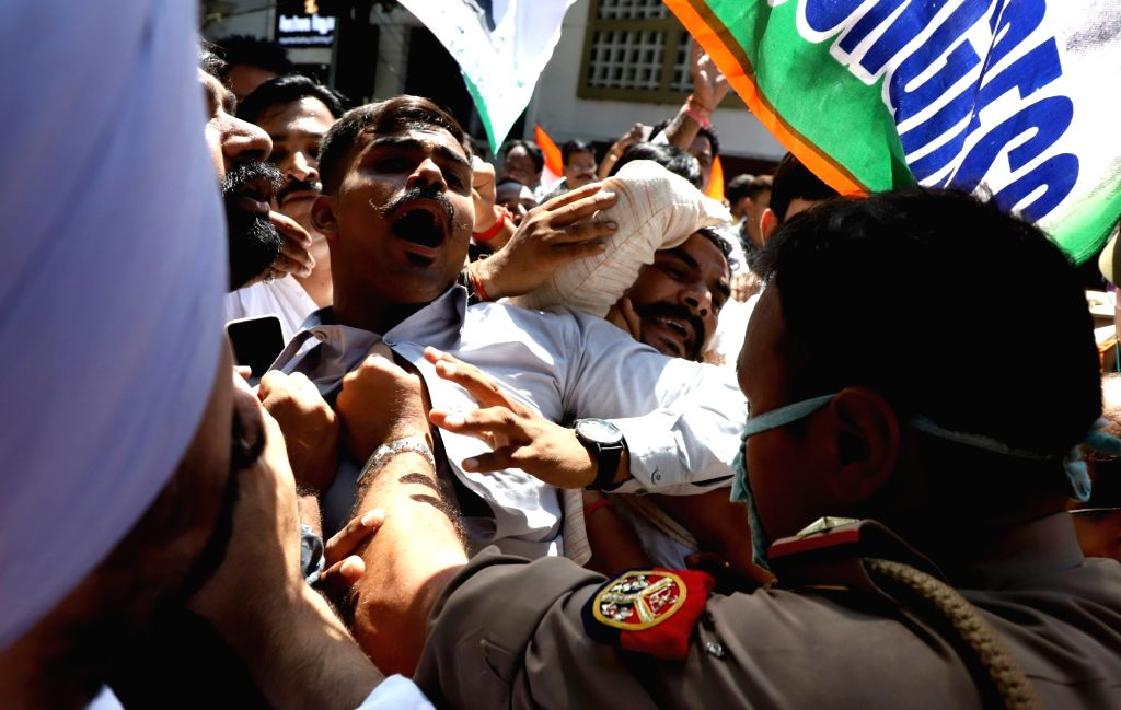 Police personnel stop Congress party workers during a protest over lodging of  FIR against senior party leader Pramod Tiwari and legislature party leader Aradhana Mishra in Lucknow Tuesday ... - Aradhana Mishra