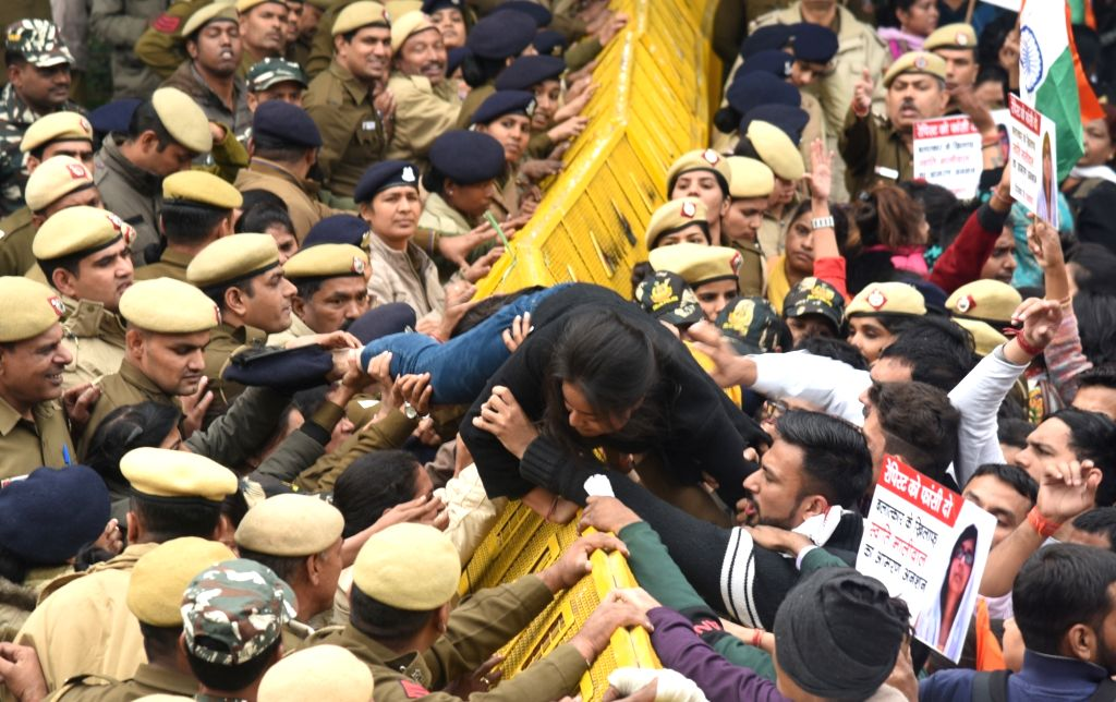 Police personnel stop protesters during a protest march organised to express support to Delhi Commission for Women (DCW) chief Swati Maliwal who is on an indefinite hunger strike demanding ...