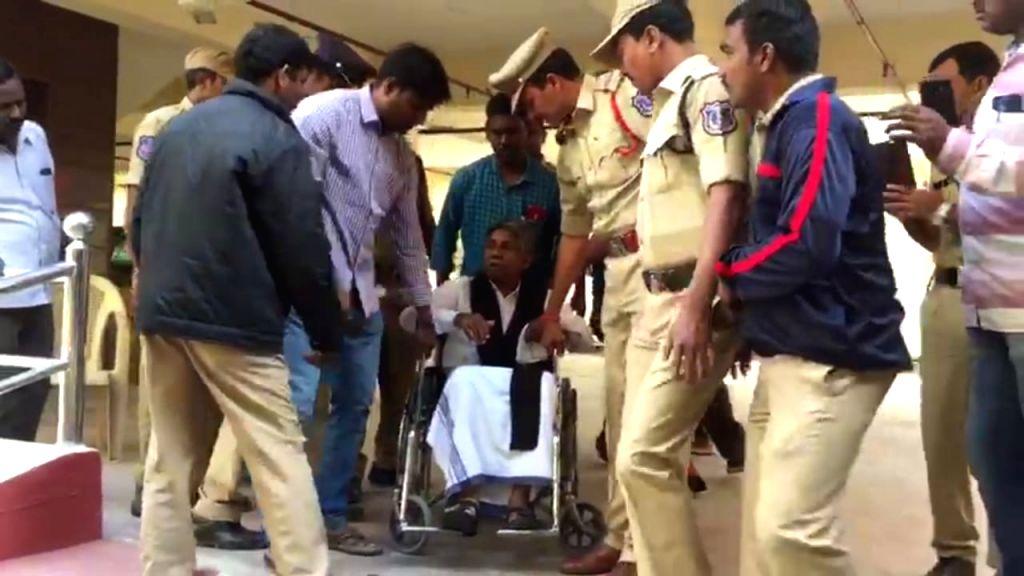 Police personnel take away MRPS founder president Manda Krishna Madiga into preventive custody in view of proposed dharna at Indira Park; in Hyderabad on Nov 17, 2019.