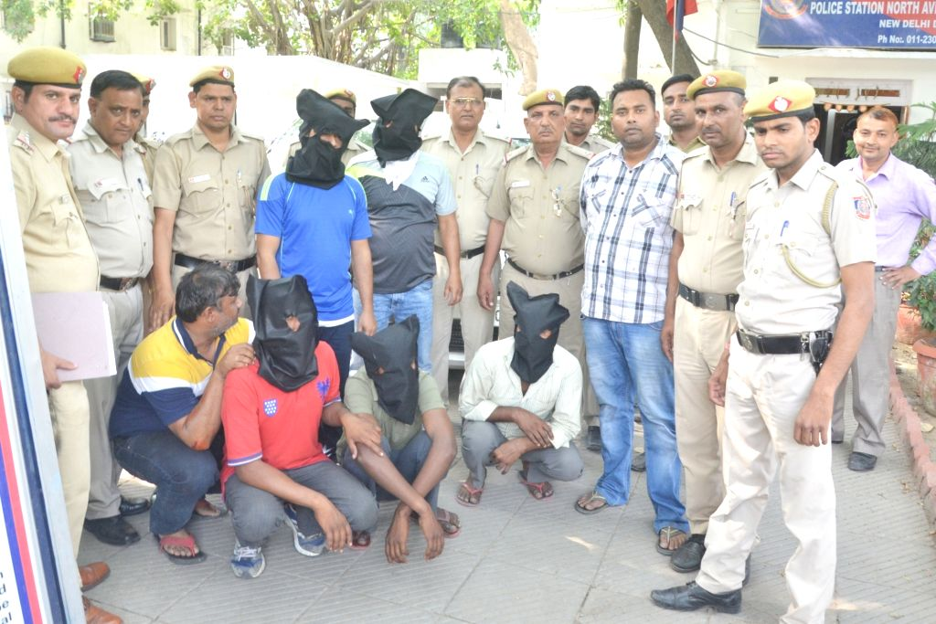 Police present before press people arrested in connection with an attack on the house of Delhi BJP Chief Manoj Tiwari in New Delhi on May 2, 2017.