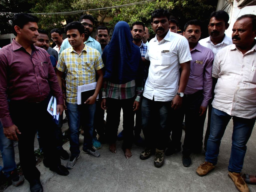 Police present before press Sana-ul-Haq Hussain, who allegedly killed his elder brother Zia-ul-Haq Hussain over a monetary dispute near a hotel in Dharavi; in Mumbai on March 14, 2017.