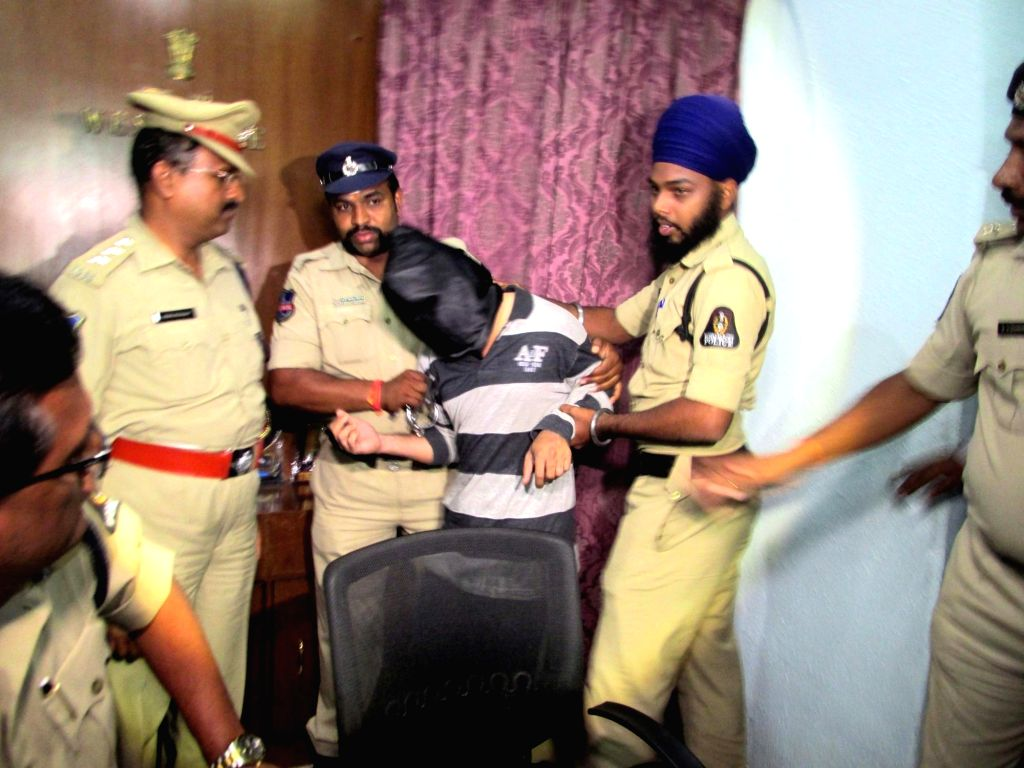 Police presents before the media a man accused of sexually assaulting a minor, in Hyderabad on Sept 16, 2018.