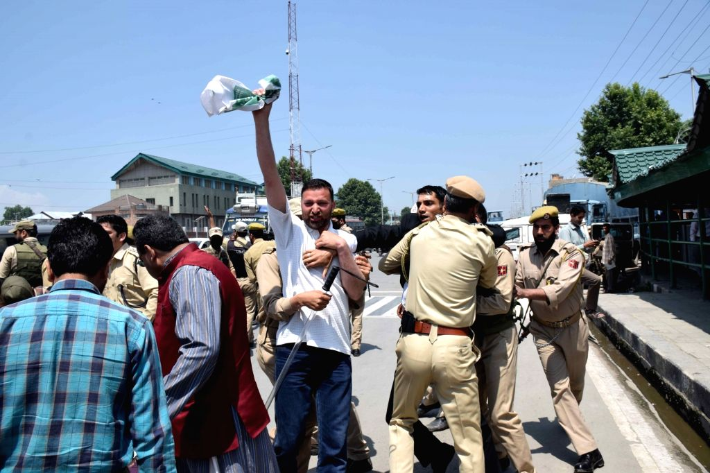 Police prevent local journalists from protesting on the first death anniversary of noted Kashmiri editor Shujaat Bukhari in Srinagar on June 14, 2019.
