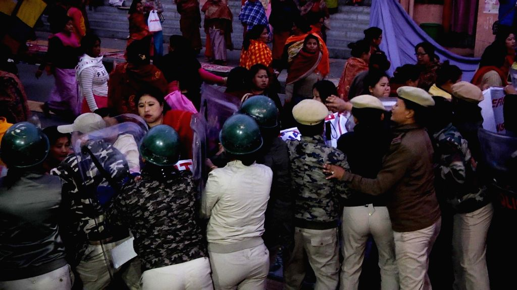 Police prevent women vendors from continuing their sit-in protest against Citizenship (Amendment) Bill that they started on Saturday in the main market complex in Imphal, on Feb 10, 2019.