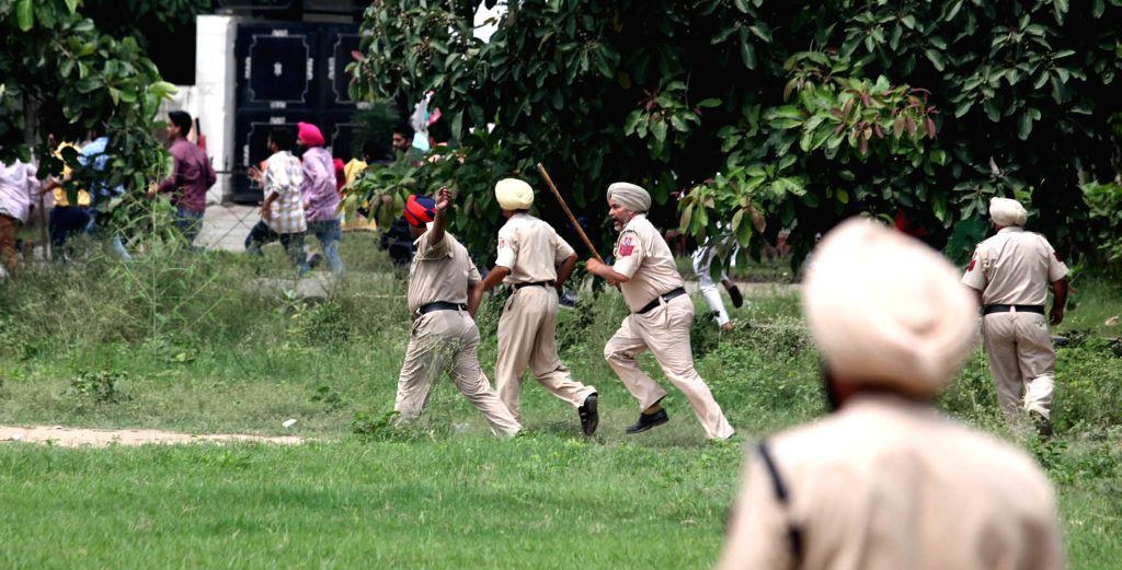 Police resort to lathi charge as Congress and Shiromani Akali Dal clashed in Mohali, on Aug 18, 2015.