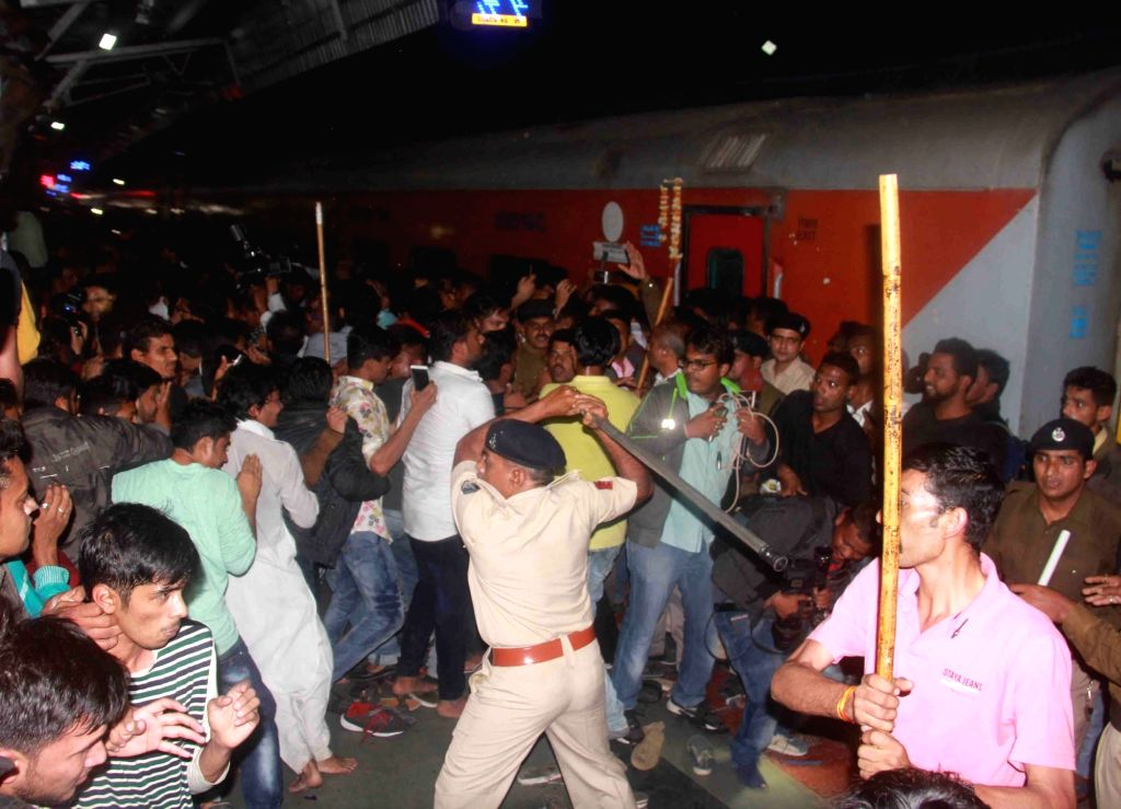 Police resort to lathi charge at Vadodra railway station to control crowd that had gathered to get a glimpse of actor  Shah Rukh Khan on Jan 23, 2017. Khan traveled from Mumbai to Delhi on ... - Shah Rukh Khan