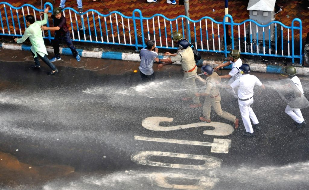 Police resorts to baton charge to disperse BJP workers protesting over the spurt in dengue cases, in Kolkata on Nov 13, 2019.
