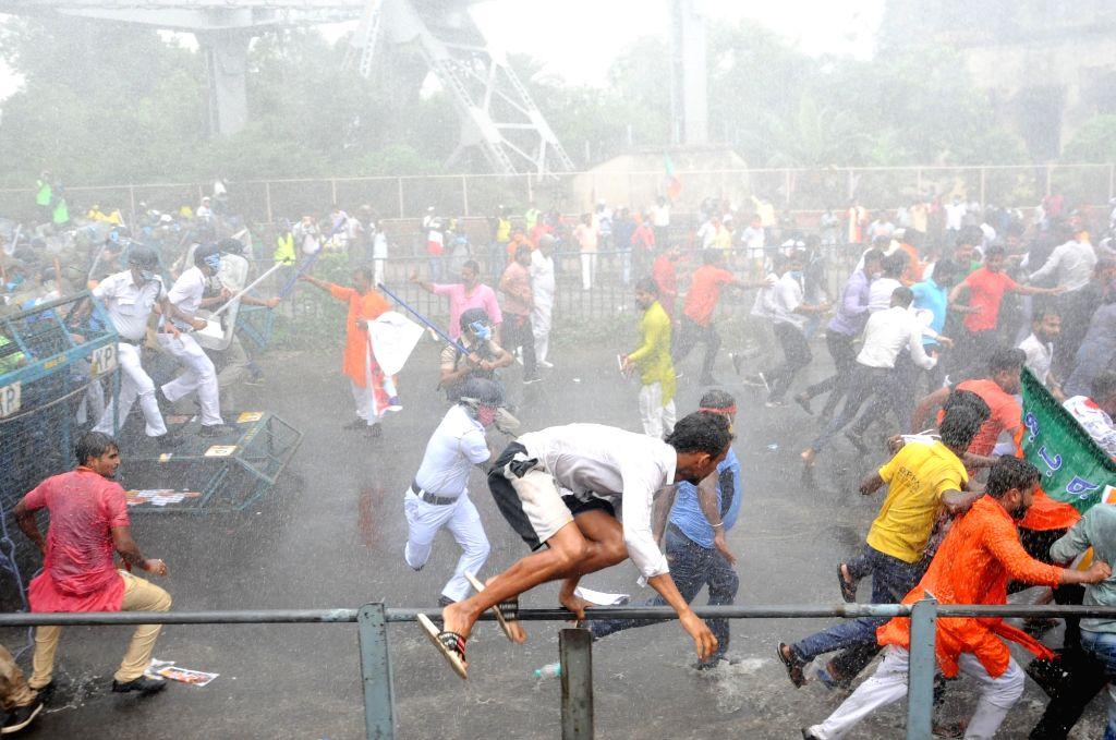 Police resorts to water cannon, baton charge and tear gas shells to disperse Bharatiya Janata Yuva Morcha activists during their 'Nabanno Chalo Abhiyaan' at Howrah Bridge, while they were ... - Mamata Banerjee