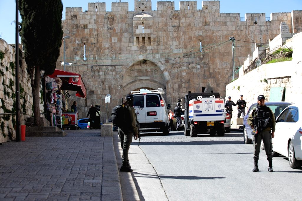 Police stand guard near Lions Gate in Jerusalem's Old City on Feb. 6, 2020. Israeli border police officers shot dead a Palestinian gunman after he shot and wounded ...